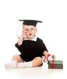 O bebê no academician veste-se com rolo e livro imagens de stock