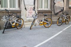 Bicycle sharing, bikes in row. O-Bike Bicycle-sharing system in Vienna, 3 bikes parked on sidewalk, Vienna Austria 2-04-2018 Royalty Free Stock Photo