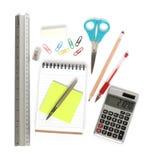 O bloco de notas da régua scissors a calculadora da pena Fotos de Stock