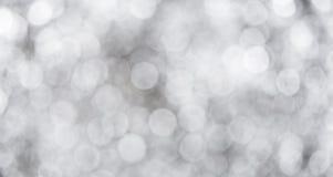 O bokeh cinzento com fundo branco do sumário da cor pode ser uso como o wa fotografia de stock royalty free