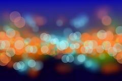 O bokeh colorido da noite borra o fundo Fotografia de Stock Royalty Free
