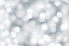 O bokeh obscuro claro de prata comemora o fundo Fotografia de Stock