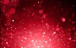 O bokeh vermelho ilumina o fundo Imagens de Stock