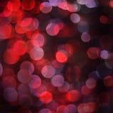 O bokeh vermelho ilumina o fundo Fotos de Stock