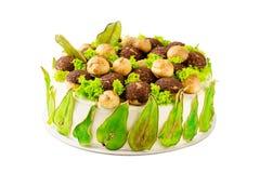 O bolo caseiro decorado com verde coloriu peras e profiterole imagem de stock royalty free