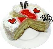 O bolo do dia do Valentim com corações vermelhos da geléia cutted Foto de Stock