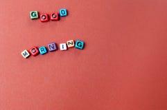 O bom dia das palavras soletrou para fora em grânulos do cubo Fotografia de Stock