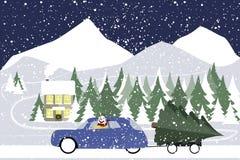 O boneco de neve conduz em um carro retro em uma estrada do inverno Imagens de Stock
