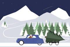 O boneco de neve conduz em um carro retro em uma estrada do inverno Fotos de Stock