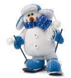 O boneco de neve no esqui isolou-se fotos de stock