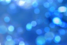 O borrão azul natural sparkles fundo abstrato imagem de stock royalty free