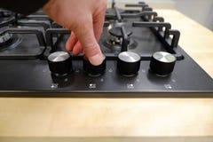 O botão controla a posição dos modos para cozinhar no forno opinião do close-up de cima de fotos de stock