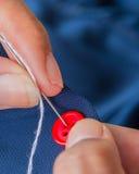 O botão da costura significa matérias têxteis e costureira de Stitchwork imagens de stock