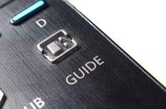 O botão do guia no telecontrole da tevê Fotos de Stock