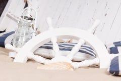 O branco envia a roda enterrada na areia Fotografia de Stock Royalty Free