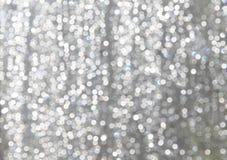 O branco Sparkles com azul Gray Background de lite Imagens de Stock Royalty Free