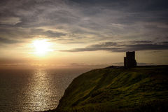 O'Brien Tower at the Cliffs of Moher. Sunset view at the O'Brien Tower at the Cliffs of Moher Royalty Free Stock Image