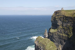 O' Briens Tower looks out over Atlantic Ocean. Atop Cliffs of Moher, County Clare, Ireland Royalty Free Stock Image