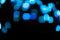 O brilho azul ilumina o fundo defocused fotografia de stock