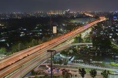 O brilho da cidade de Jakarta na noite Imagem de Stock