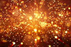 O brilho digital do Natal acende a explosão dourada do bokeh das partículas no fundo preto imagens de stock royalty free