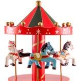 O brinquedo colorido com cavalos, fim do carrossel acima, isolou o fundo branco Imagens de Stock Royalty Free