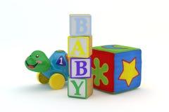 O brinquedo de madeira obstrui o bebê da soletração Fotografia de Stock Royalty Free