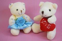 O brinquedo macio carrega em um fundo cor-de-rosa foto de stock royalty free
