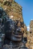 O Buddah de pedra enfrenta no templo de Bayon no complexo de Angkor, Camboja fotografia de stock
