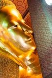 O Buddha de reclinação Imagens de Stock