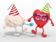 O cérebro e o coração com braços, pés no carnaval party Fotos de Stock Royalty Free