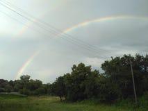 O céu com dois arcos-íris foto de stock royalty free