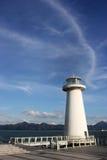 O céu, a costa e o farol de Bule Imagem de Stock