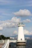 O céu, a costa e o farol de Bule Fotos de Stock Royalty Free