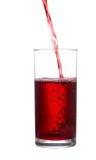 O córrego do suco flui em um vidro Imagem de Stock