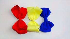 O cabelo curva-se/vermelho, amarelo, e azul Fotografia de Stock