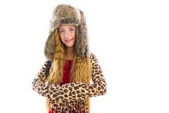 O cabelo longo da menina loura da criança do inverno com pele veste-se Fotos de Stock