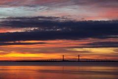 O cabo ficou a ponte no por do sol Imagem de Stock