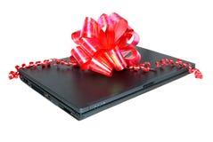 O caderno é um presente Fotos de Stock Royalty Free