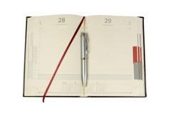 O caderno e a prata ballpen Fotografia de Stock Royalty Free