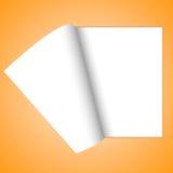 O caderno está vazio na laranja Imagens de Stock