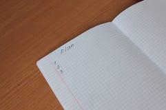 O caderno na tabela Imagem de Stock