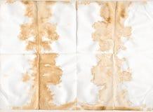 O café e o chá mancharam papel velho textured foto de stock royalty free