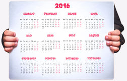 O calendário das crianças para 2016 está guardando uma criança Imagens de Stock
