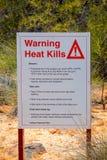 O calor de advert?ncia mata o aviso do sinal sobre o calor extremo no interior australiano imagem de stock