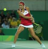 O campeão olímpico Monica Puig de Porto Rico na ação durante mulheres do tênis escolhe o final do Rio 2016 Jogos Olímpicos Imagem de Stock