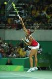O campeão olímpico Monica Puig de Porto Rico na ação durante mulheres do tênis escolhe o final do Rio 2016 Jogos Olímpicos Fotografia de Stock Royalty Free