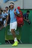 O campeão Juan Martin Del Potro do grand slam de Argentina incorpora a corte antes que os homens escolham o final do Rio 2016 Jog Imagens de Stock