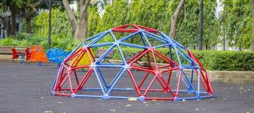 O campo de jogos das crianças no parque público Fotografia de Stock