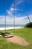 O canto do balanço do mar na praia Fotografia de Stock